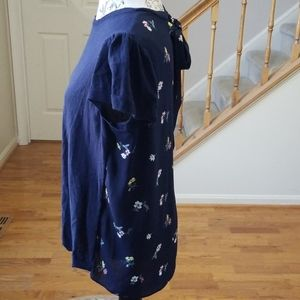 Pretty navy front w floral back shirt